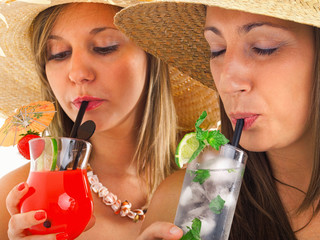 Young girls drinking cocktails