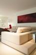 Beige sofa inside designed room
