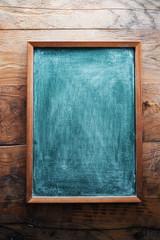Chalkboard on wooden background