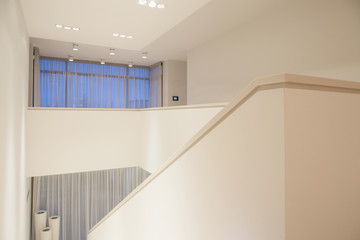 Interior of bright staircase inside apartment