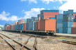 Cargo train platform with freight train container at depot - 76132124