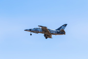 L-39 albatros fighter jet flying on blue sky background