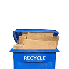 Front of flattened corrugated boxes in recycling bin, vertical