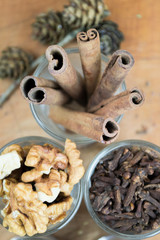Glasses of  spices, cinnamon, nuts, allspice, sesame on a wooden