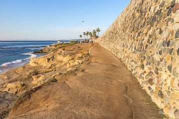 Cliff dirt path and rock wall facing the ocean