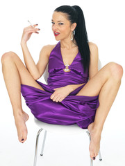 Attractive Sexy Young Woman Wearing A Purple Evening Dress