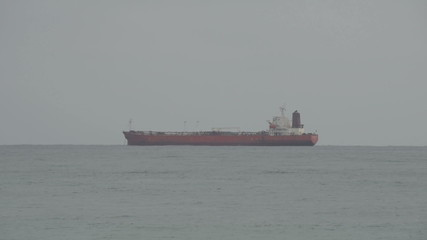 Cargo ship at sea side view