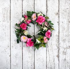 Flower wreath on vintage white background