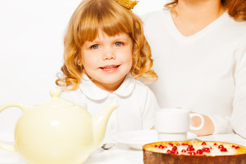 Girl with tea and cake portrait