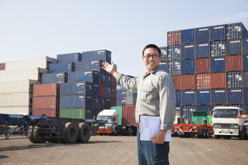 happy man in front of container truck