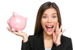 Woman holding piggy bank screaming excited