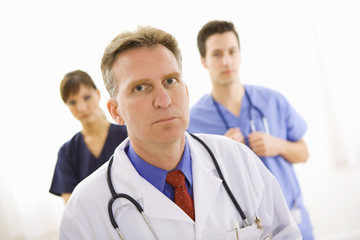 Doctors: Serious Male Physician with Others