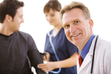 Doctors:  Cheerful Doctor with Patient and Nurse