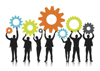 Silhouetts of Business People Holding Gears