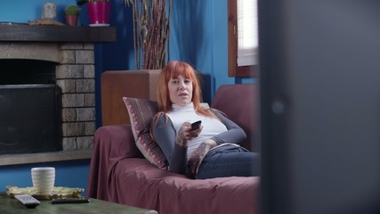 Woman Girl Watching Tv Television Relaxing On Sofa At Home