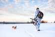 canvas print picture - hunter with a dog on a frosty day