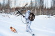 hunter with dog in winter - 76137381