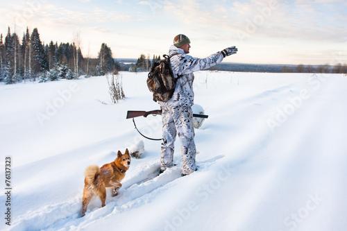 Fotobehang Jacht hunter on the snowy road