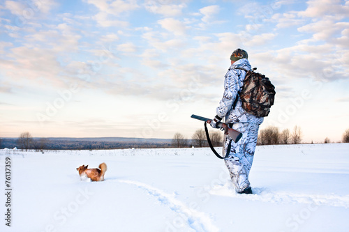 hunter with a dog on a frosty day - 76137359