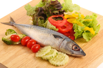 Atlantic mackerel and vegetables on wooden cutting board