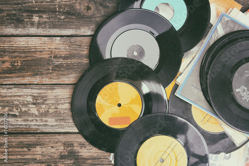 close up image of old records over wooden background , image is - 76137706