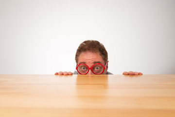 Peeking over the table