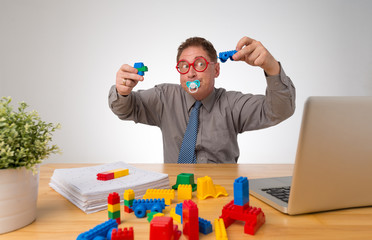Businessman playing lego