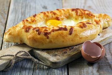 Georgian cheese pie and egg yolk.