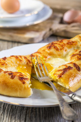 Cut pie with cheese and egg yolk.