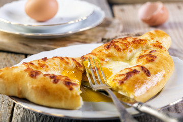 Cut Adjara khachapuri. Cheese pie.