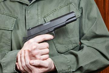 Soldier in uniform holding gun Colt
