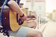 Close up of human hands playin guitar