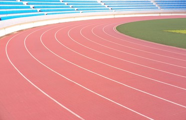 Athletic running track with stadium seats in background