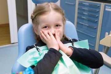 The little girl afraid in the dental clinic
