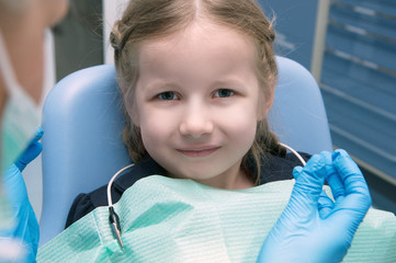 The little girl in the dental clinic