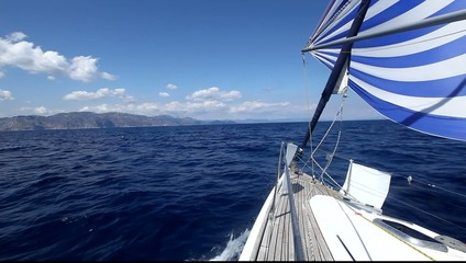 Luxury yachts. Sailing in the wind through the waves.