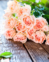 Bouquet of Pink Roses on Wooden Table