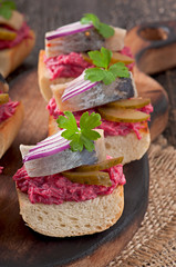 Sandwiches with herring, beetroot and pickled cucumber