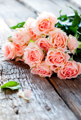 Bouquet of Tender Pink Roses on Wooden Table