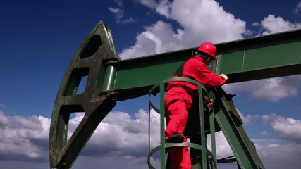 Oil Worker and Pump Jack Drilling Rig