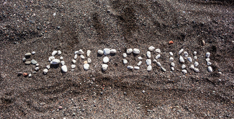 Text Santorini made with pumice stones