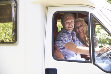 Couple Driving Motor Home On Vacation