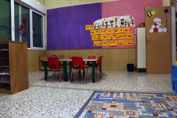 Preschool classroom with red chairs and table