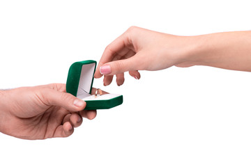 Hand giving box with a wedding ring