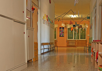 corridor of a nursery with the decorations hung on walls