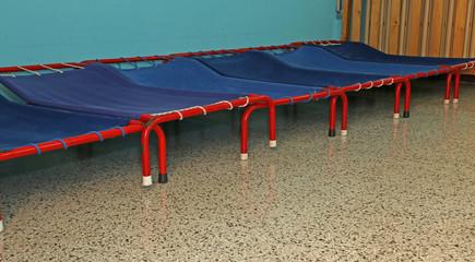 small beds of a dormitory of kindergarten children