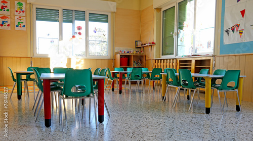 interiors of a kindergarten class with the chairs and children's - 76144527