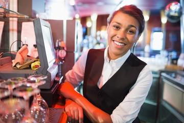 Pretty barmaid smiling at camera
