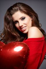 Beautiful brunette young woman with balloon