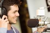 Portrait of an university student recording audio poster